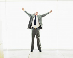 Businessman Stretching Out Arms in Joy